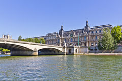 """Bridge """"Pont Royal"""" and famous museum Louvre Royalty Free Stock Image"""
