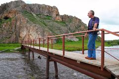 On the bridge. Altay. Russia Stock Images