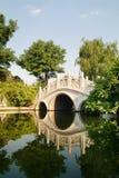 Bridge. White curved bridge in the parks Stock Photo