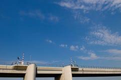 Bridge. Modern concrete bridge against a blue sky Stock Images
