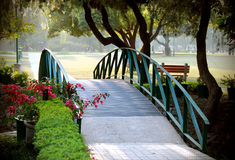 Bridge. A bridge in the park with soft sunlight in the background Stock Photos