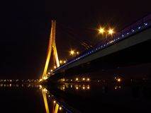 Bridge. And reflection in a river at night Gdansk, Poland stock photo
