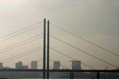 Bridge. In the evening in city fog; silhouette Royalty Free Stock Photography