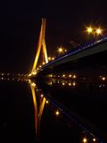 Bridge. And reflection in a river at night Gdansk, Poland royalty free stock photography