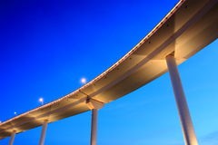 Bridge. In the night  on blue sky background Royalty Free Stock Photo