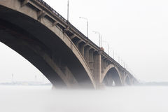 Bridge. Russia, Krasnoyarsk. Kommunalny Bridge - the automobile and foot bridge through the river Yenisei Royalty Free Stock Photography
