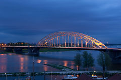 The bridge. The (in the Netherlands) well known bridge over the Waal, an offspring of the Rhine, in the city of Nijmegen, the Netherlands Royalty Free Stock Images