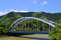 The Bridge. Over the blue sky and  the mountain Stock Photo
