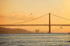 Bridge 25th of April in Lisbon, Portugal. At sunset Royalty Free Stock Images