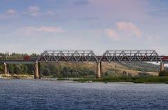 Bridge. Train on the long bridge over the river Stock Image