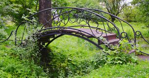 Bridge. In a botanical garden Royalty Free Stock Photo