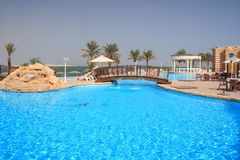 Bridge. A swimming pool near the sea in Qatar Royalty Free Stock Photos