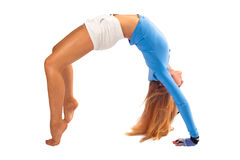 Bridge. Beautiful blond girl in tension in gymnastic pose Stock Image