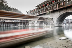 Bridge. This is the ancient Chinese bridge, I use slow shutter recording it and a moving boat, because the boat close to me, so you will feel very shocked Royalty Free Stock Photography