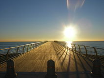 Bridge. Wooden bridge  in early morning light at the sea Stock Images