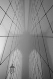 Bridge. Cables leading to the main tower of the Brooklyn Bridge on a foggy morning Stock Photos