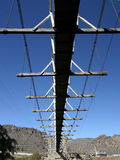 The Bridge. Underside view of a suspension bridge, New Zealand royalty free stock photo