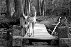 The Bridge. Young girl walking on bridge Royalty Free Stock Image