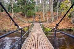 Chain bridge over a river in Estonia. A photo of an old chain bridge in Keila-Joa, Estonia Royalty Free Stock Image