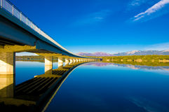 Bridge. Long bridge crossing the water reservoir Royalty Free Stock Photo