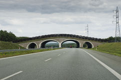 Bridge above the empty highway in the countryside,Europe. Royalty Free Stock Photo