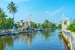 The bridge above Hamilton`s Canal in Wattala, Colombo. COLOMBO, SRI LANKA - DECEMBER 7, 2016: The bridge above the Hamilton`s Canal in Wattala suburb is Royalty Free Stock Images