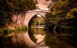 Bridge above the lake, sunset time Royalty Free Stock Image
