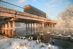 The bridge above the river in the winter Stock Image