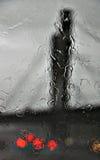 Bridge abstract with rain on glass. And car lights Stock Photos