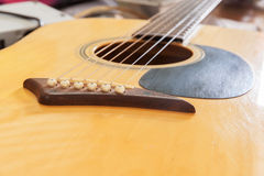 Bridge acoustic guitars. Six strings for background Stock Photography