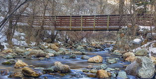 The Bridge Across. The Big Cottonwood River up Big Cottonwood Canyon in the Wasatch mountains of Utah USA in January Stock Images