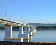The bridge across the Angara River. Beautiful white yellow bridge over the River. Stock Photo