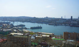 The bridge across the Bay, in the port city. sunny day and flourishing greenery, Vladivostok. Marine City high bridge across the Bay, the sunny weather and Royalty Free Stock Photo