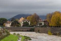 Bridge across of Bisenzio River and river shore. Prato. Tuscany. Italy. Stock Image