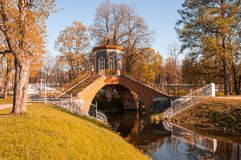 Bridge across canal in Alexander`s park Royalty Free Stock Images