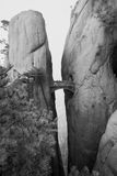 Bridge across chasm. Fairy walking bridge in Huangshan, China, perilously perched over a deep chasm between granite pillars Royalty Free Stock Photography