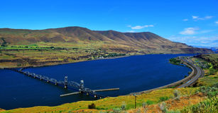Bridge across the Columbia River in Eastern Oregon HDR. Columbia river in Eastern Oregon with I84 on the right and a bridge leading you into Washington state in royalty free stock photo