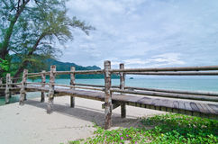 Bridge across Datai beach, Langkawi, Malaysia. The Andaman Sea is in the Horizon royalty free stock photo