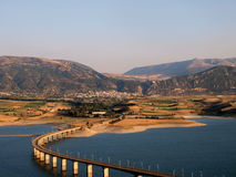 Bridge across Greek lake. A view of a long, curving highway bridge across Lake Polifitos, Greece royalty free stock images