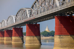 The bridge across Irrawadee river and the old pagodas in Sagaing Area. Royalty Free Stock Photo