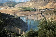 Bridge across Iznajar reservoir. Bridge over the reservoir with buildings to the rear, Iznajar, Cordoba Province, Andalusia, Spain, Western Europe Royalty Free Stock Photo