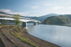 A bridge across Kawakuchigo lake. In morning with the walking way Stock Images
