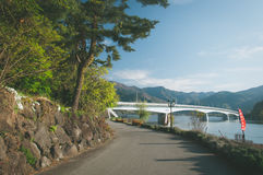 A bridge across Kawakuchigo lake. In morning with the walking way Stock Image
