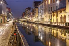 Naviglio Grande canal in Milan, Lombardia, Italy. Bridge across the Naviglio Grande canal at night, Milan, Lombardia, Italy Royalty Free Stock Photo