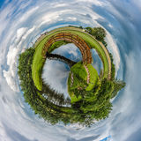 Bridge across the planet. Abstract illustration of the planet in blue skies with large wooden bridge stretching across Stock Images