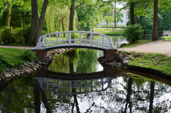 The bridge across the pond in the park, Palanga, Lithuania Royalty Free Stock Image