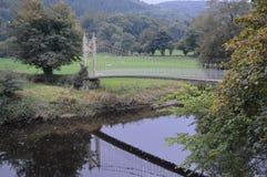 Bridge across the quiet water. Welsh countryside; bridge spanning quiet waters Stock Image