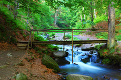 Bridge across the river Stock Images