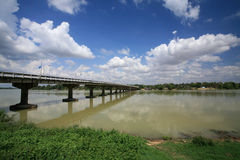 Bridge across river against blue sky and cloud Stock Photos