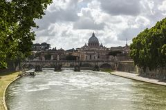 Bridge across a river with a basilica in the background Royalty Free Stock Photo